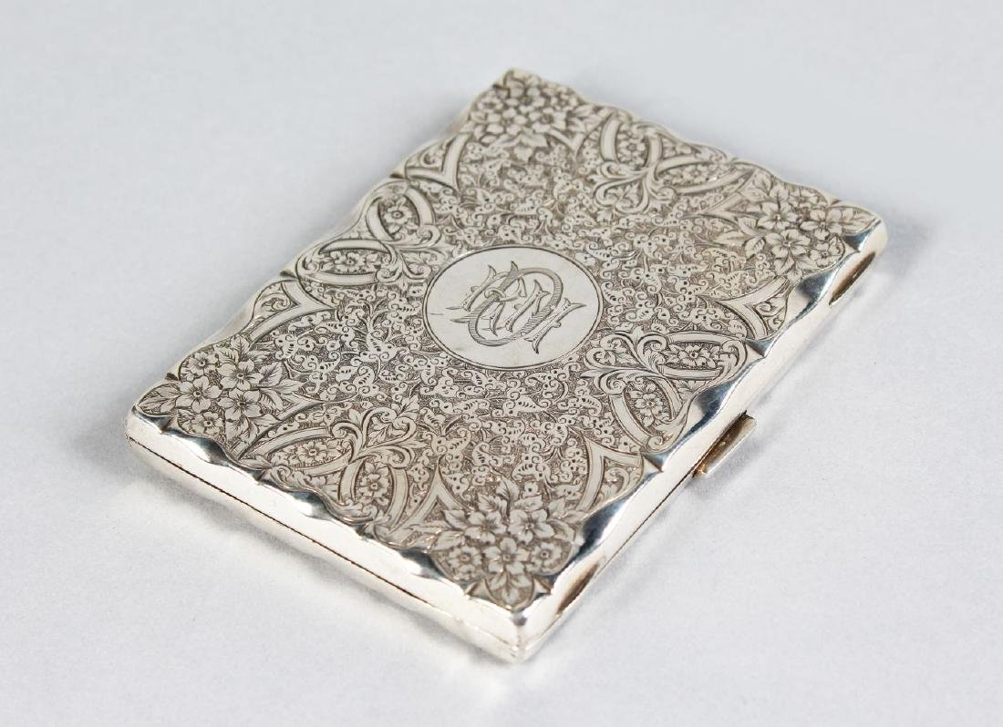 A VICTORIAN ENGRAVED SILVER CASE AND PURSE.  Birmingham
