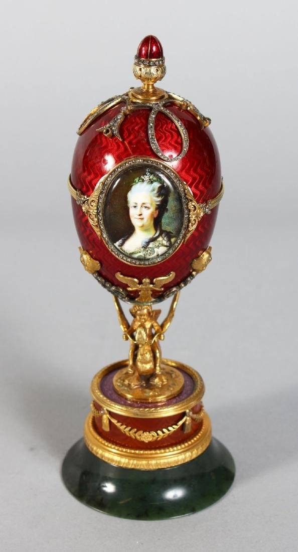 A SUPERB RUSSIAN RED ENAMEL AND SILVER GILT EGG with