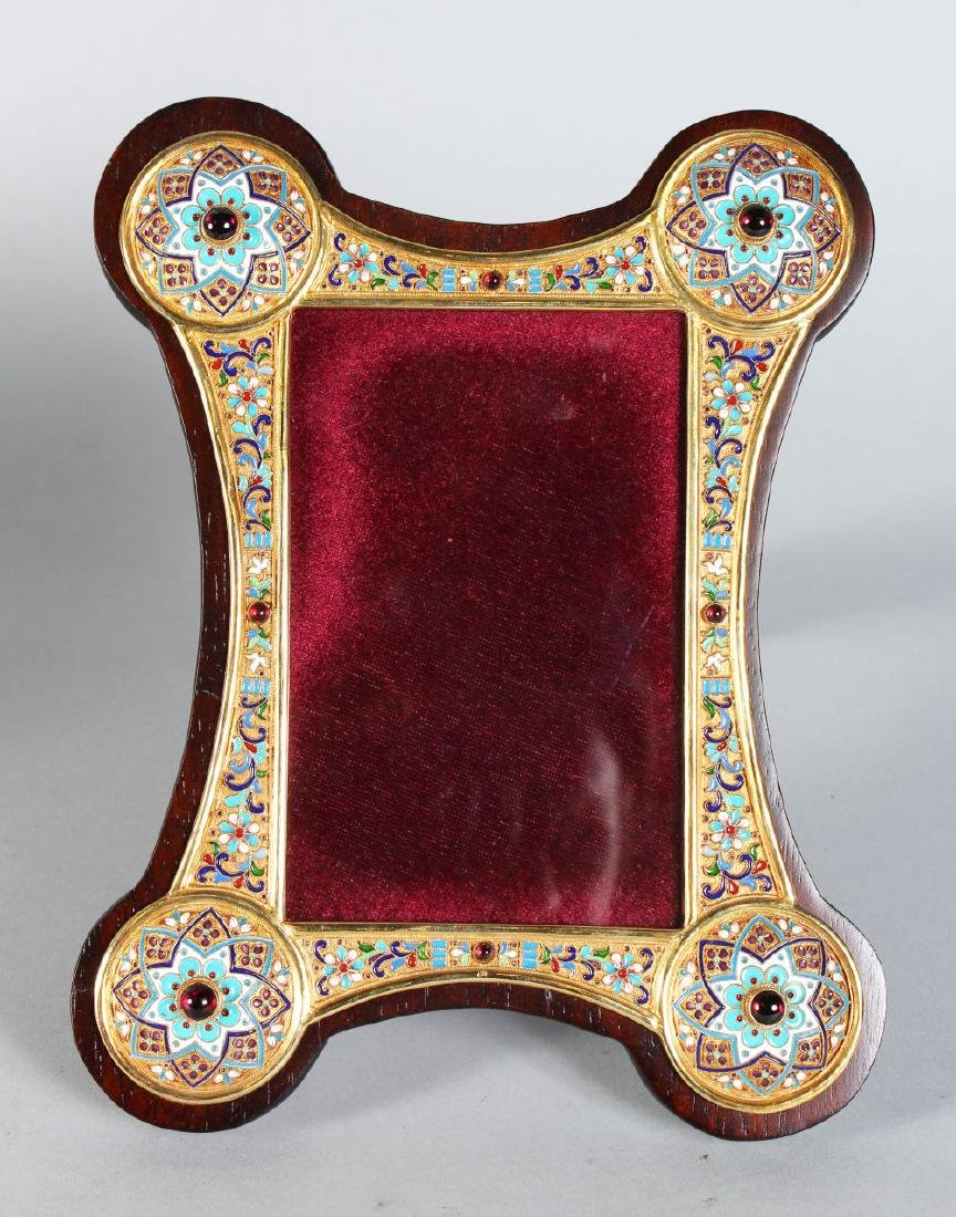 A GOOD RUSSIAN SILVER AND ENAMEL SHAPED PHOTOGRAPH