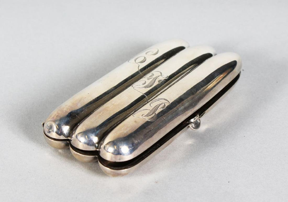 A THREE SECTION SILVER CIGAR CASE.