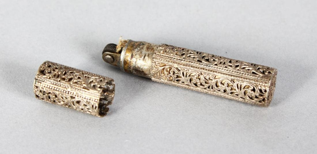 A FILIGREE LIGHTER.