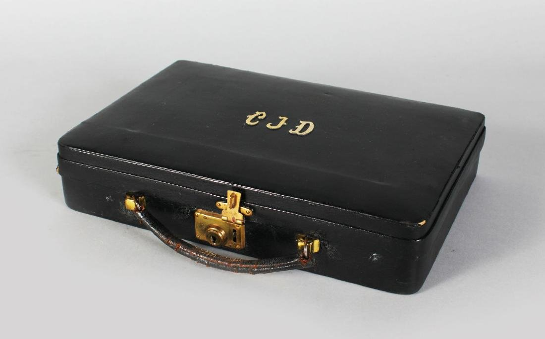 A CARTIER LEATHER JEWELLERY CASE.  10.5ins x 7ins.