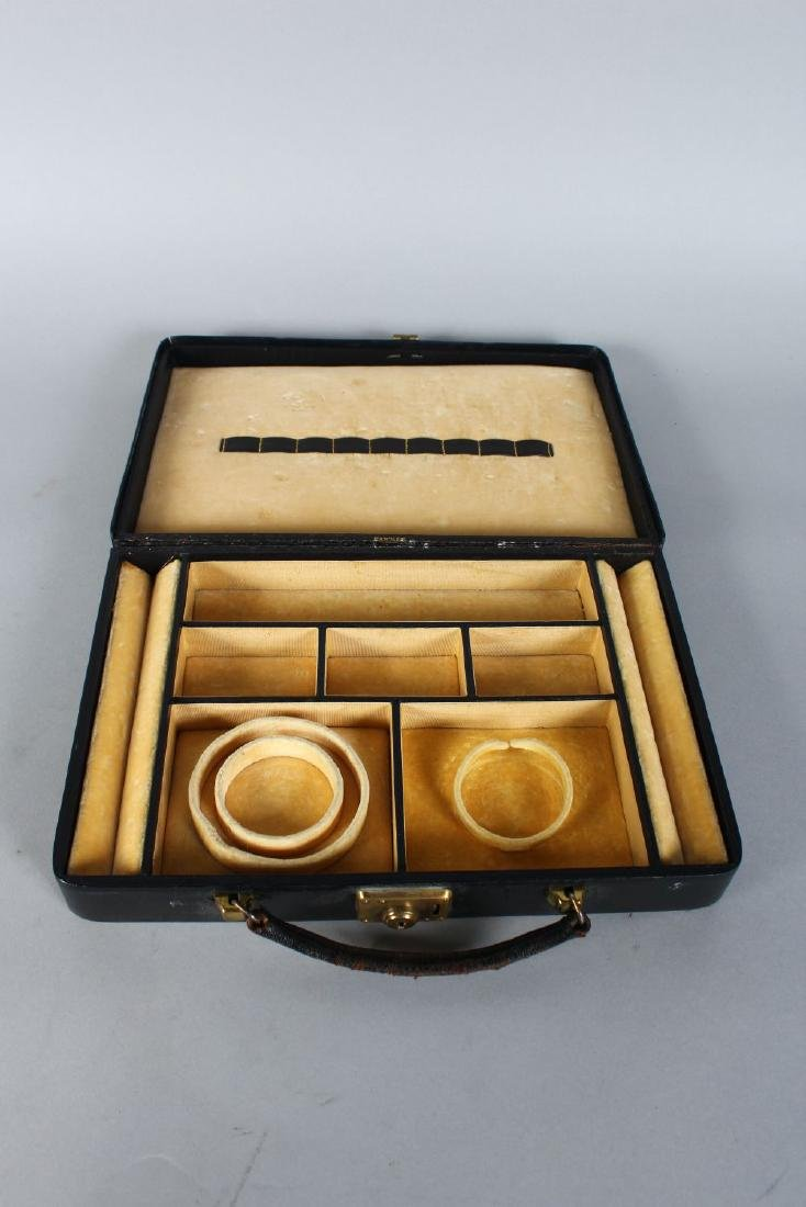 A CARTIER LEATHER JEWELLERY CASE.  10.5ins x 7ins. - 2
