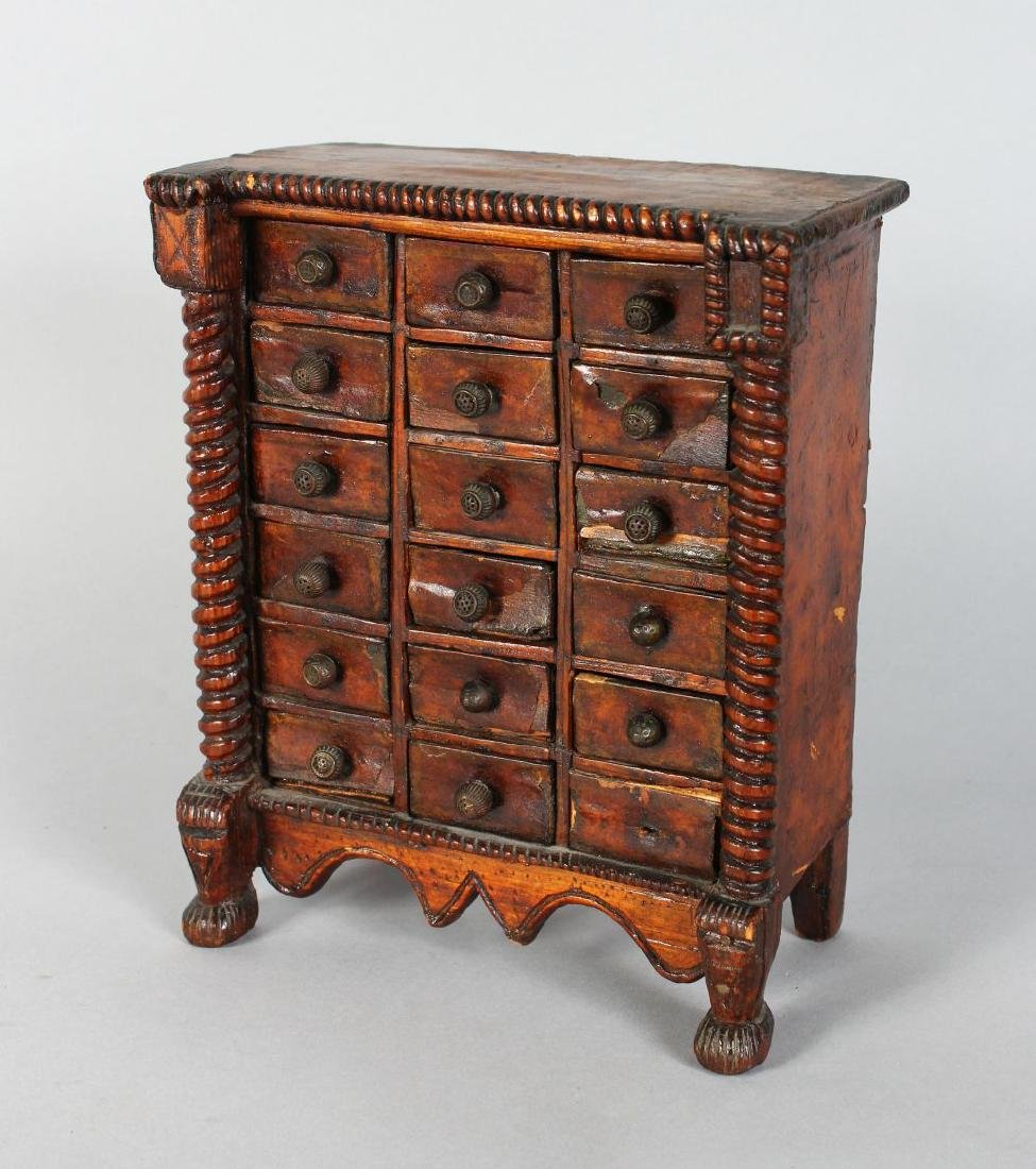 A MINIATURE SPICE CABINET with six rows of three