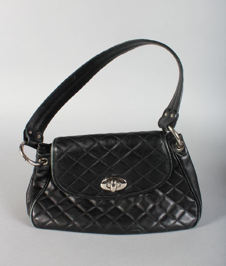 A BLACK HOBBS BAG.