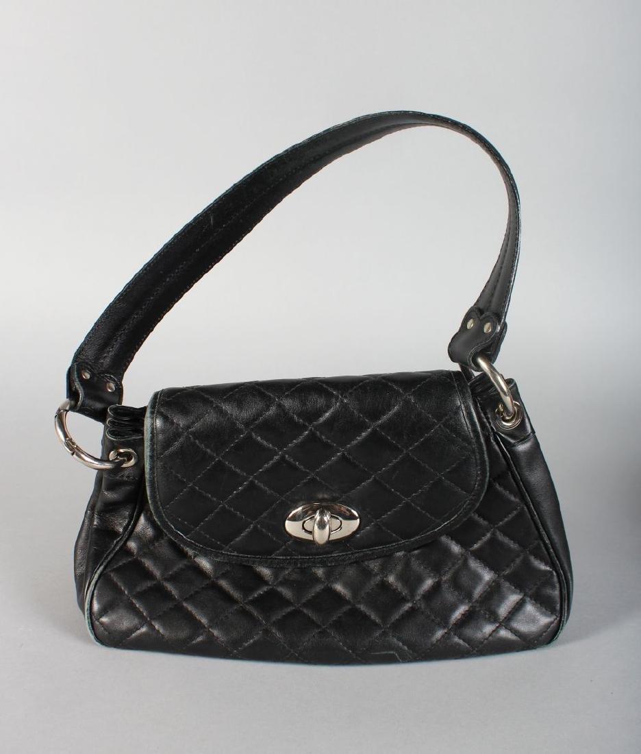 A BLACK HOBBS BAG.