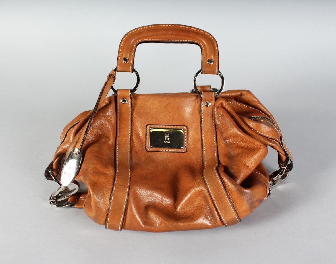A BROWN LEATHER KEM BAG.