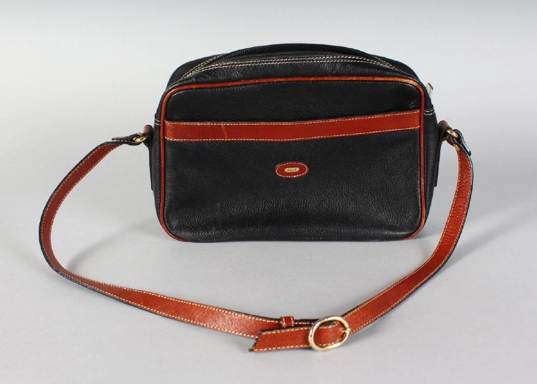 A BLACK AND BROWN BALLY BAG.