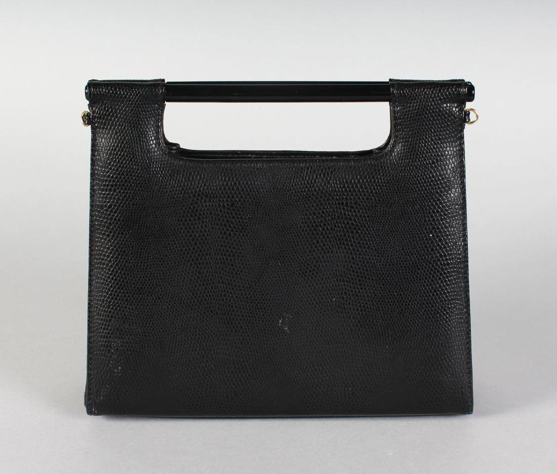A BLACK SNAKESKIN BAG, made in Italy.