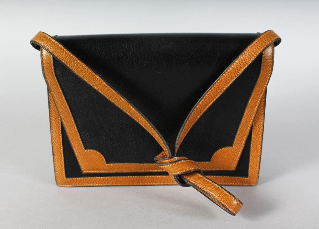 A BROWN AND TAN CELERINA BAG.