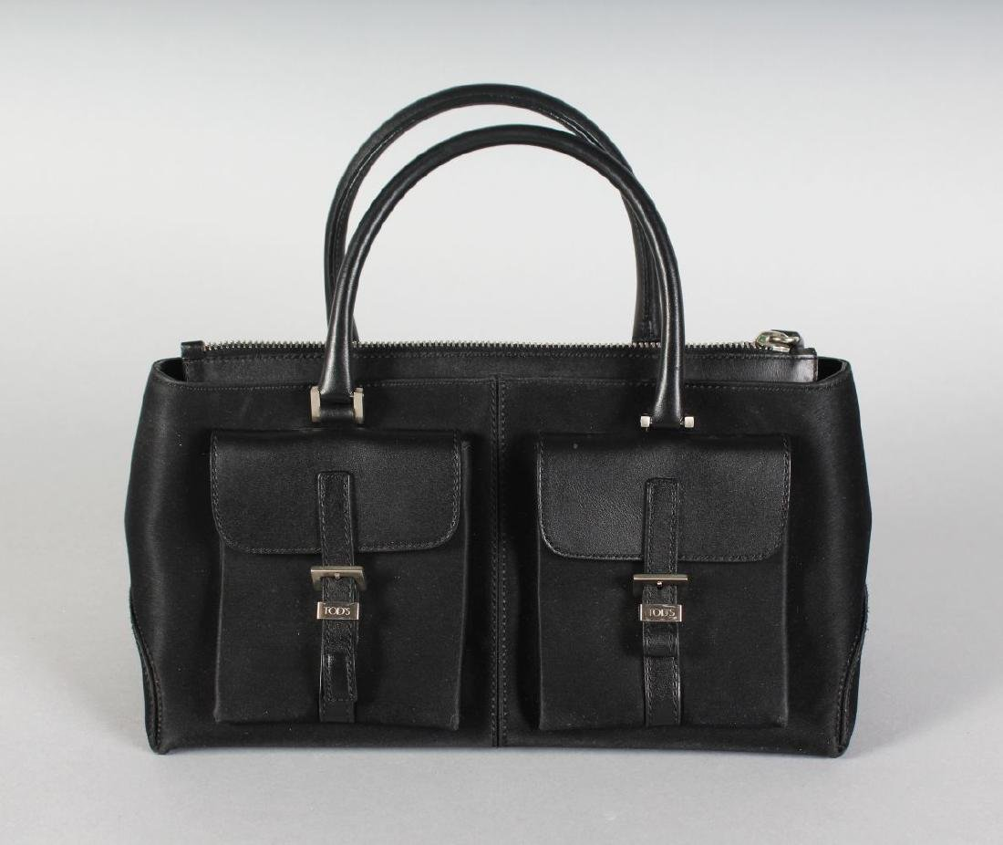 A BLACK TODS BAG.