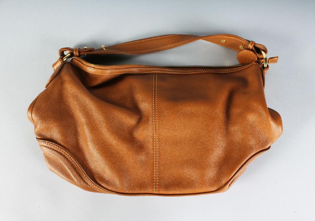 A BROWN LEATHER L. K. BENNETT BAG.