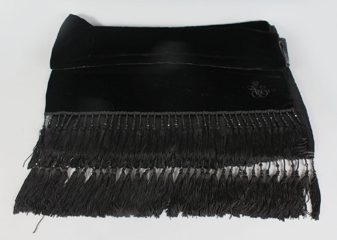 A BLACK ORIENT EXPRESS CAPE.
