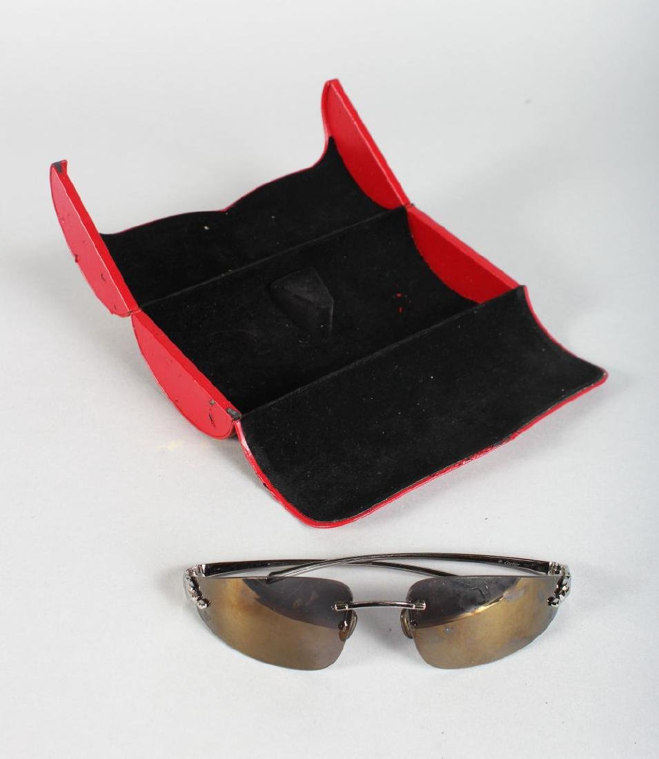 A PAIR OF CARTIER WHITE METAL PANTHER SUNGLASSES, in a