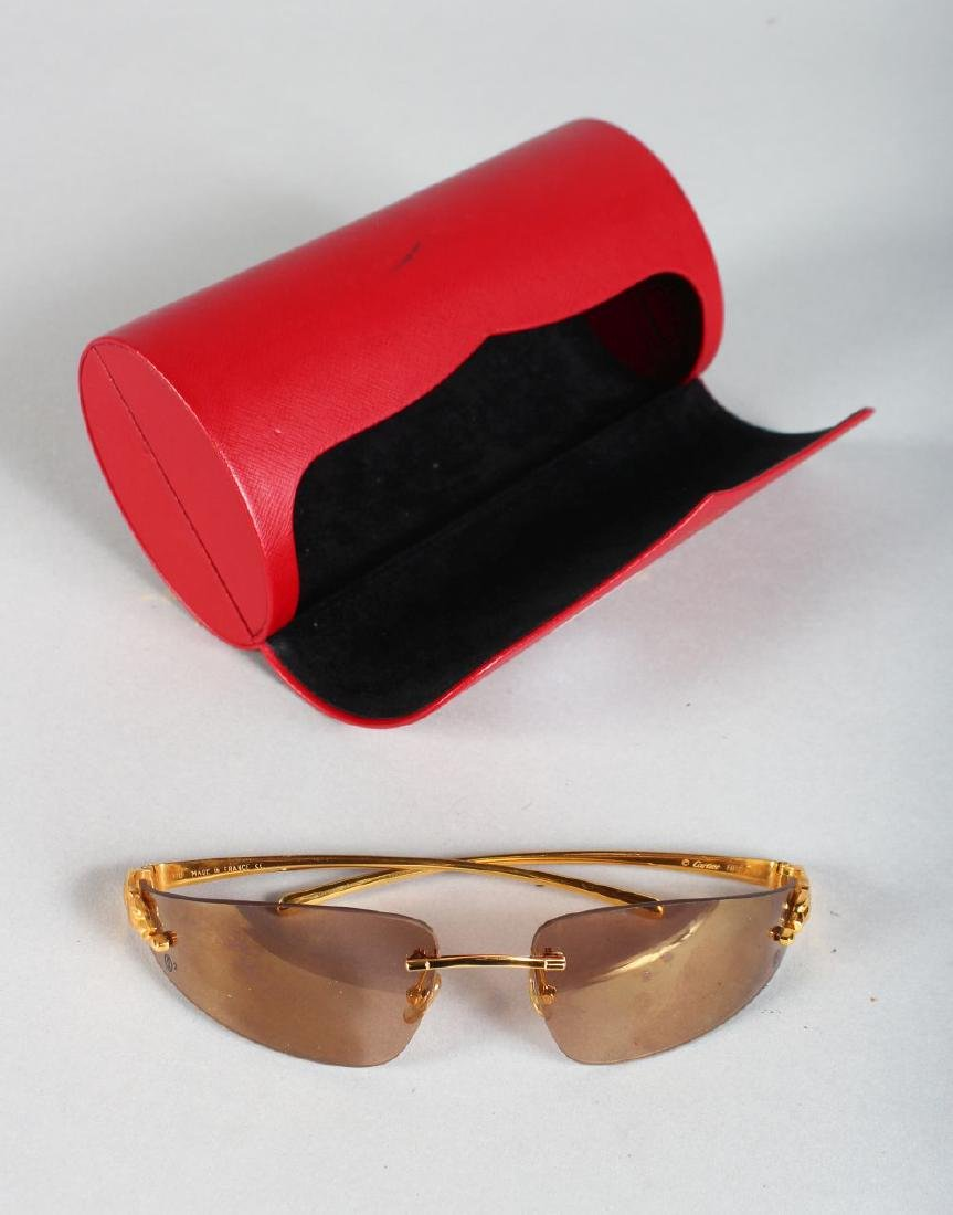 A PAIR OF CARTIER GOLD METAL PANTHER SUN GLASSES, in a