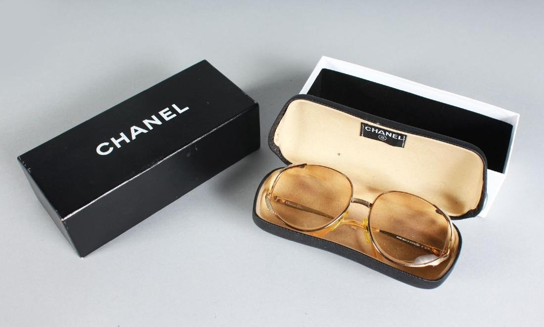 A PAIR OF CHANEL SUNGLASSES, in a Chanel box.