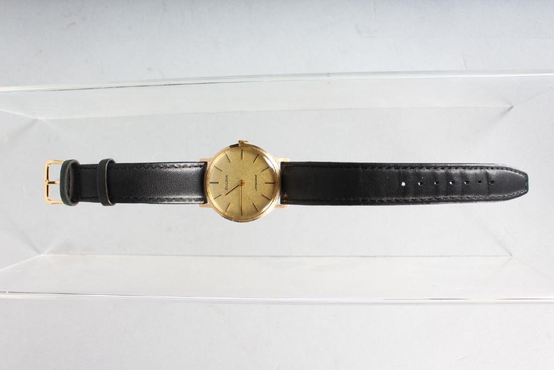 A GENTLEMAN'S GOLD BULOVA WRISTWATCH with leather - 2