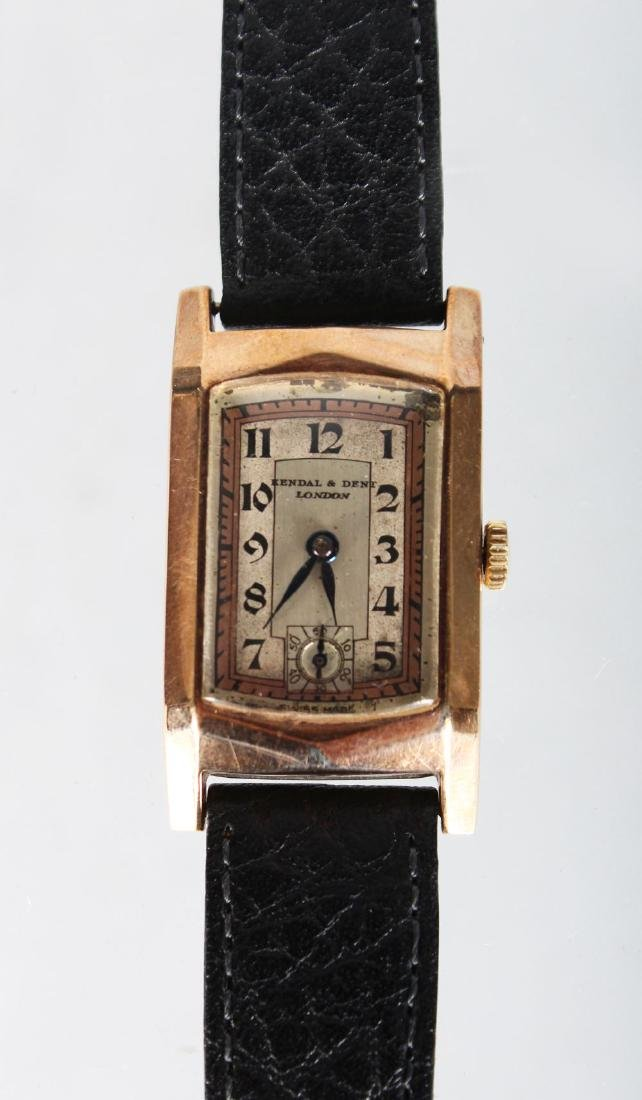 A LADIES GOLD KENDAL & DENT WRISTWATCH with leather