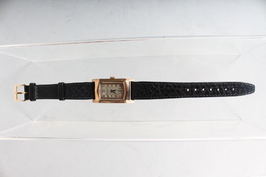 A LADIES GOLD KENDAL & DENT WRISTWATCH with leather - 2