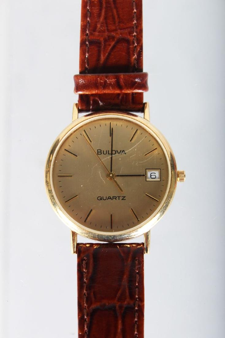 A GENTLEMAN'S GOLD BULOVA WRISTWATCH with leather
