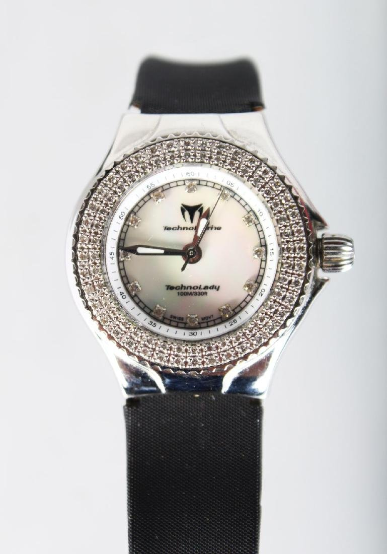 A LADIES RUSSIAN DIAMOND SET WRISTWATCH with leather