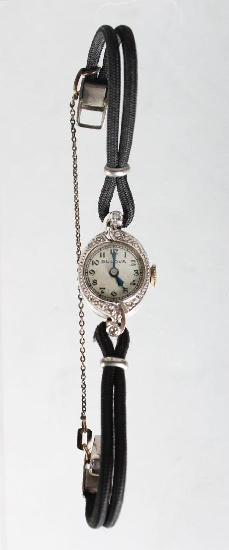 A LADIES 14CT GOLD DIAMOND SET WRISTWATCH.
