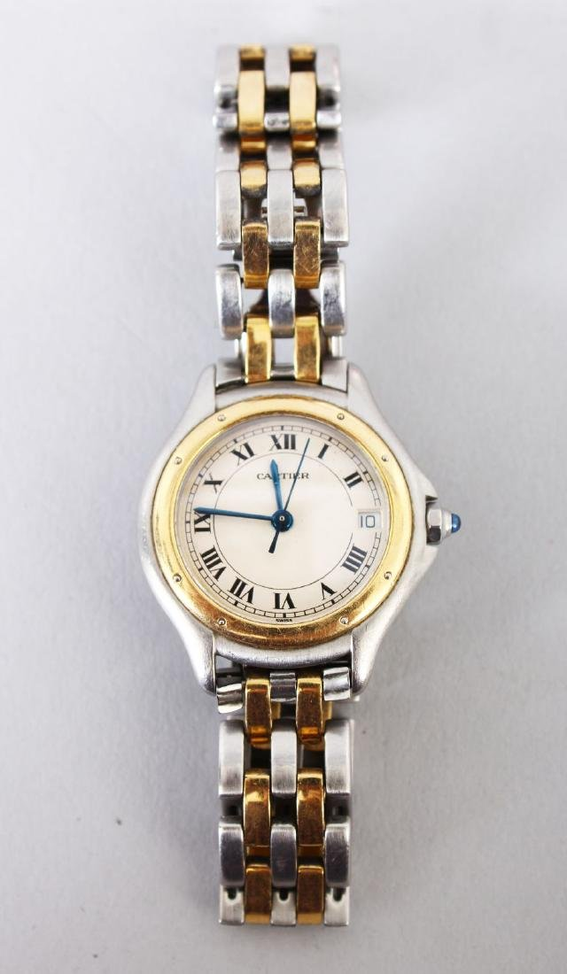 A LADIES' CARTIER STEEL AND GOLD WRISTWATCH  in