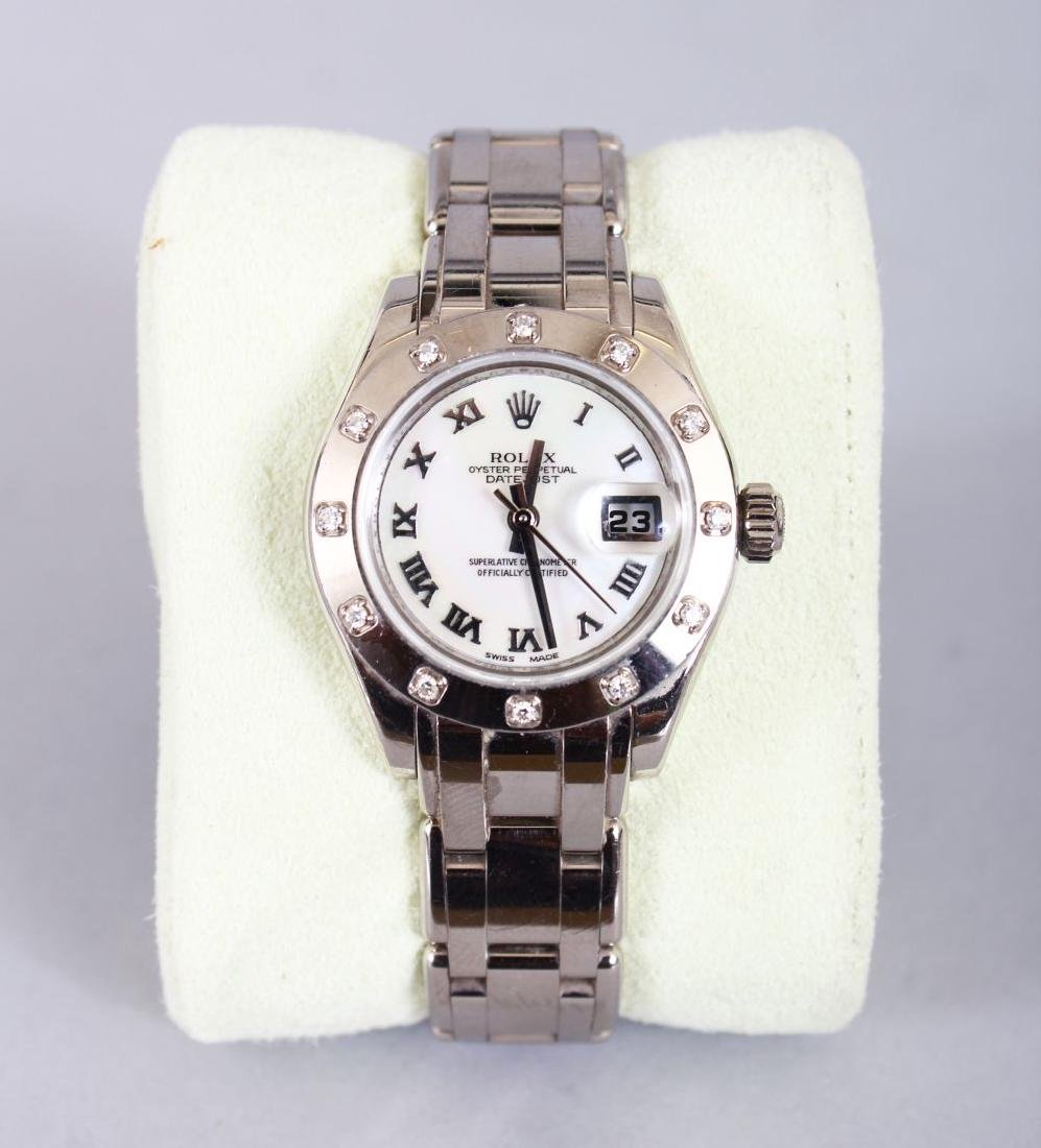 A LADIES' 18CT GOLD ROLEX with mother-of pearl face and