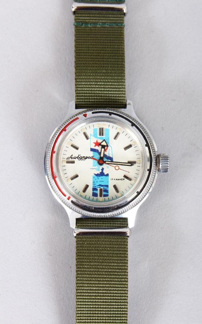A GENTLEMAN'S AUTOMATIC WRISTWATCH with strap, in a red