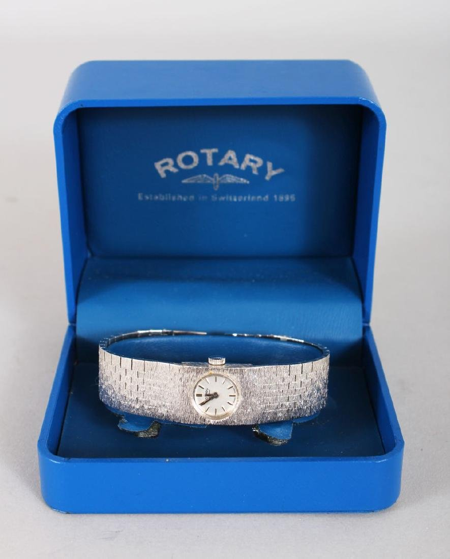 A LADIES' STEEL ROTARY WRISTWATCH with steel strap,
