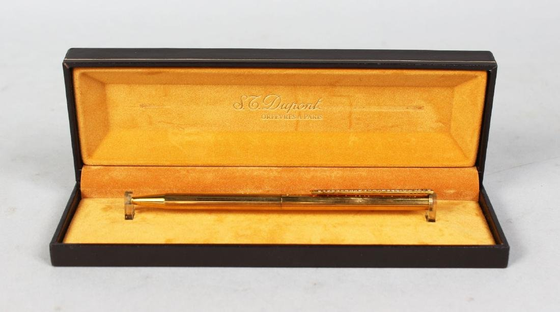 A DUPONT PEN with diamond clasp.