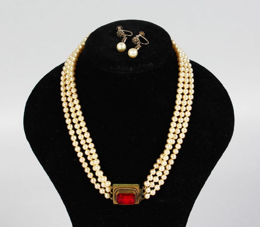 A TRIPLE ROW PEARL NECKLACE AND EARRINGS.