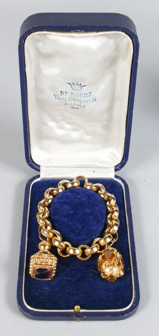 A BRACELET AND TWO FOBS.