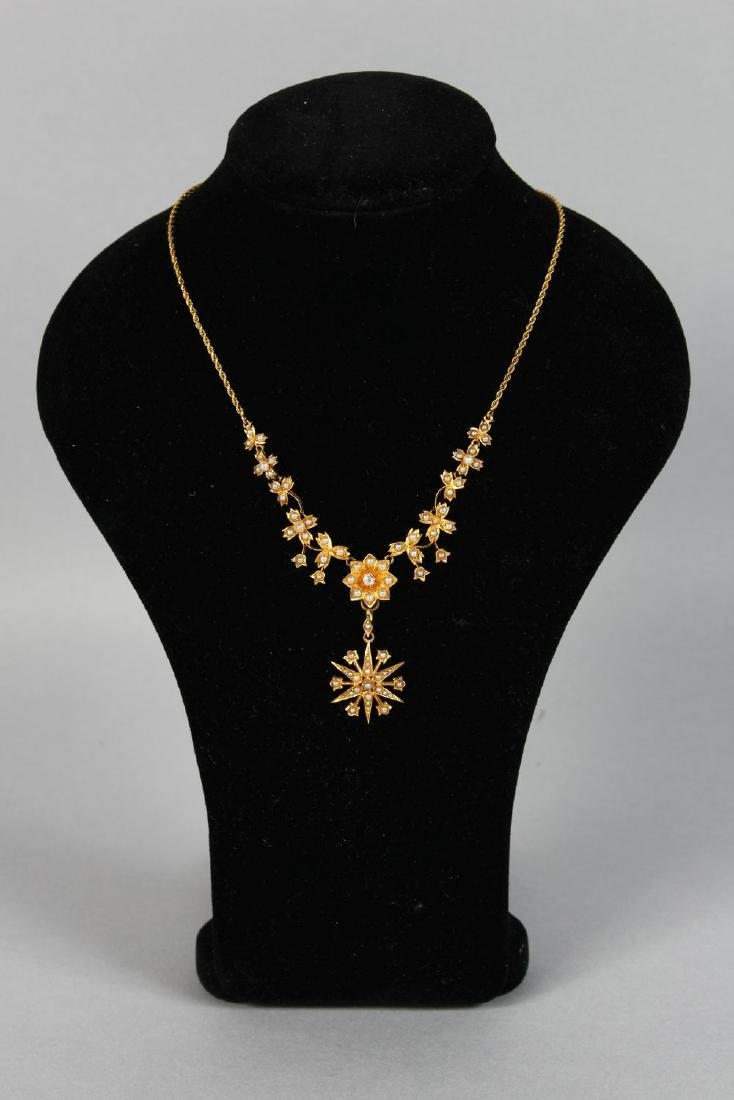 A GOLD AND SEED PEARL PENDANT AND CHAIN.