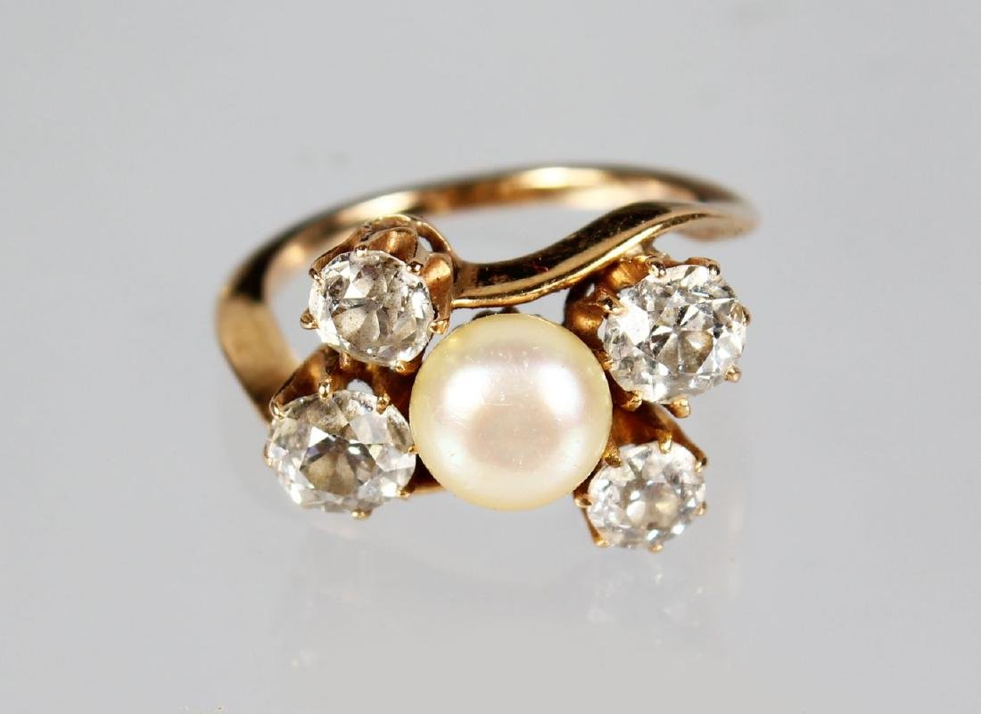 A FOUR STONE DIAMOND AND PEARL RING.