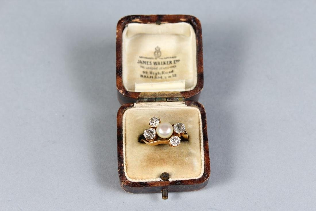 A FOUR STONE DIAMOND AND PEARL RING. - 2