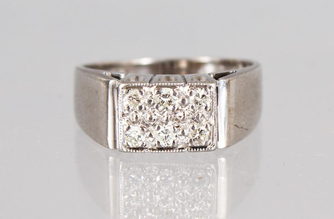 AN 18CT WHITE GOLD SIX STONE DIAMOND RING.