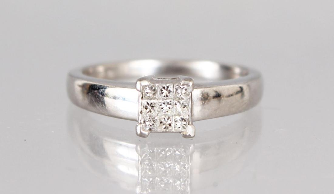 AN 18CT WHITE GOLD NINE STONE SQUARE DIAMOND RING.