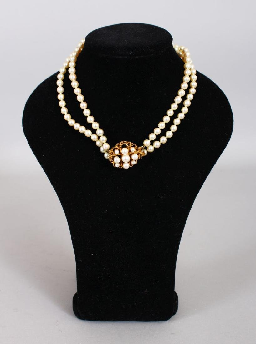 A TWO STRAND PEARL CHOKER with 9ct gold and pearl