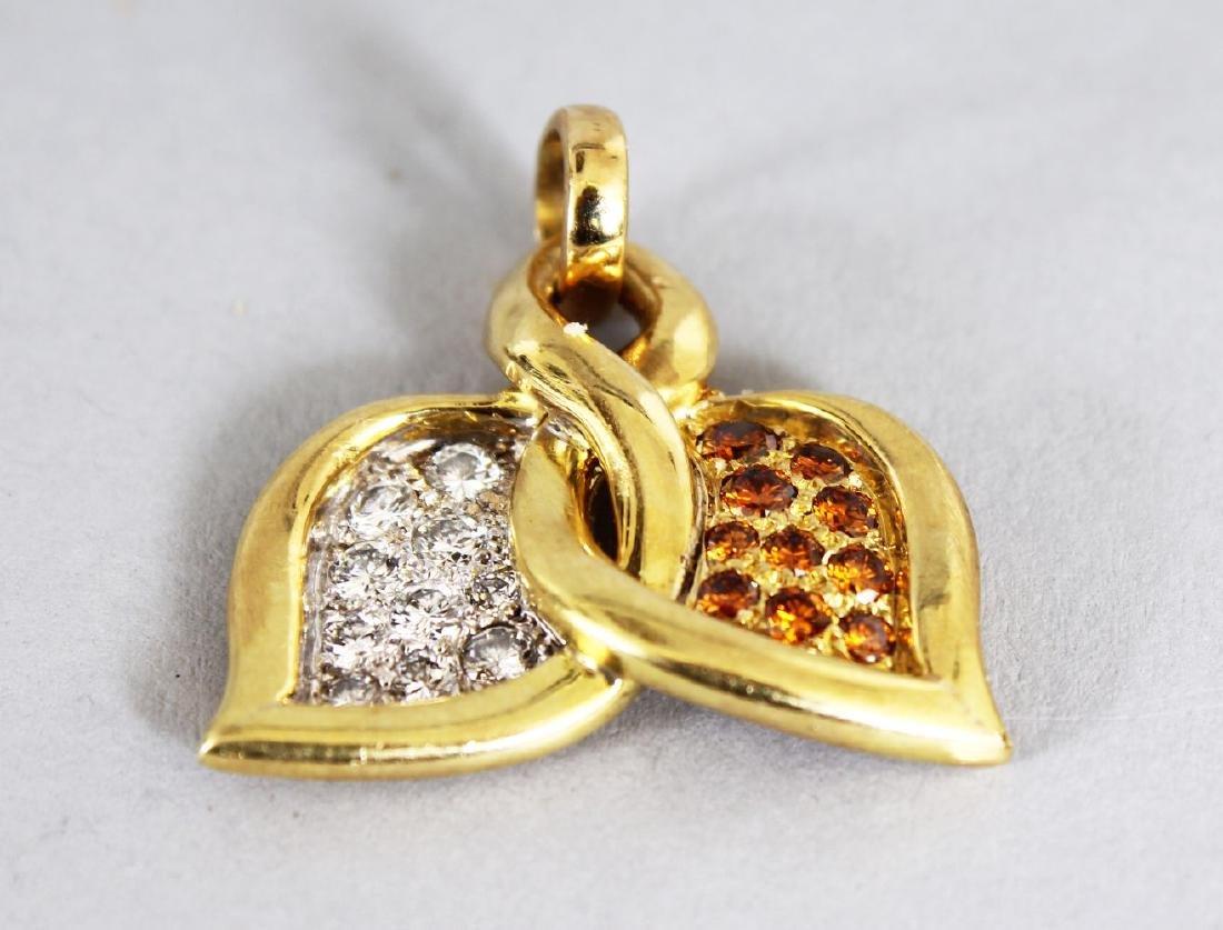 A GOOD DIAMOND SET CROSSOVER PENDANT.