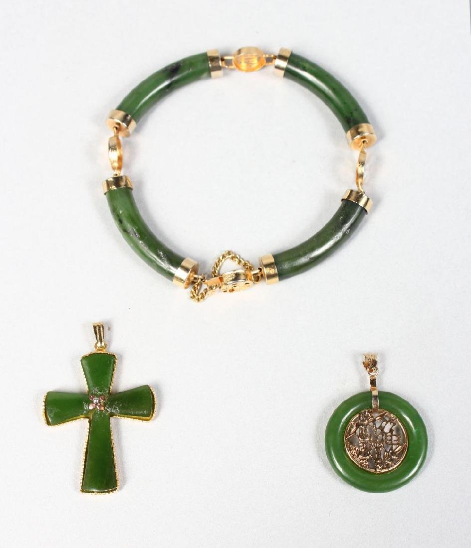A CHINESE JADE AND GOLD BRACELET with two pendants.