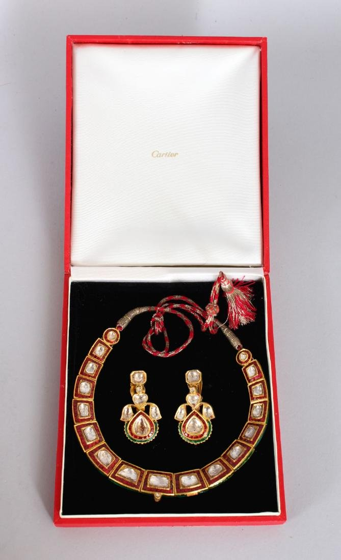 A SUPERB DIAMOND AND RUBY SET NECKLACE AND EARRINGS