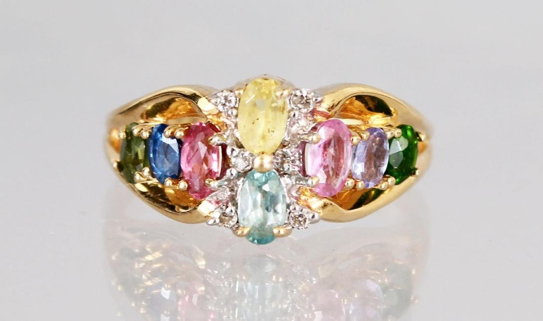 A 14CT GOLD MULTI-COLOURED STONE RING.