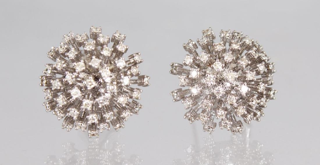 A GOOD PAIR OF 14CT WHITE GOLD AND DIAMOND SET FLOWER
