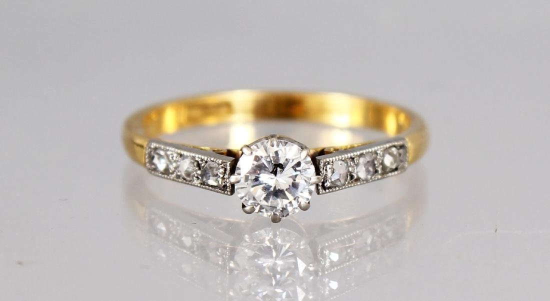 AN 18CT GOLD SOLITAIRE DIAMOND RING with diamond