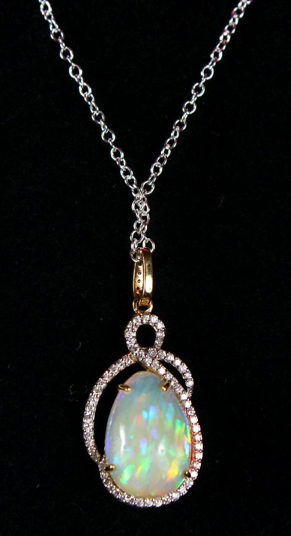 AN 18CT YELLOW GOLD PEAR SHAPED OPAL AND DIAMOND