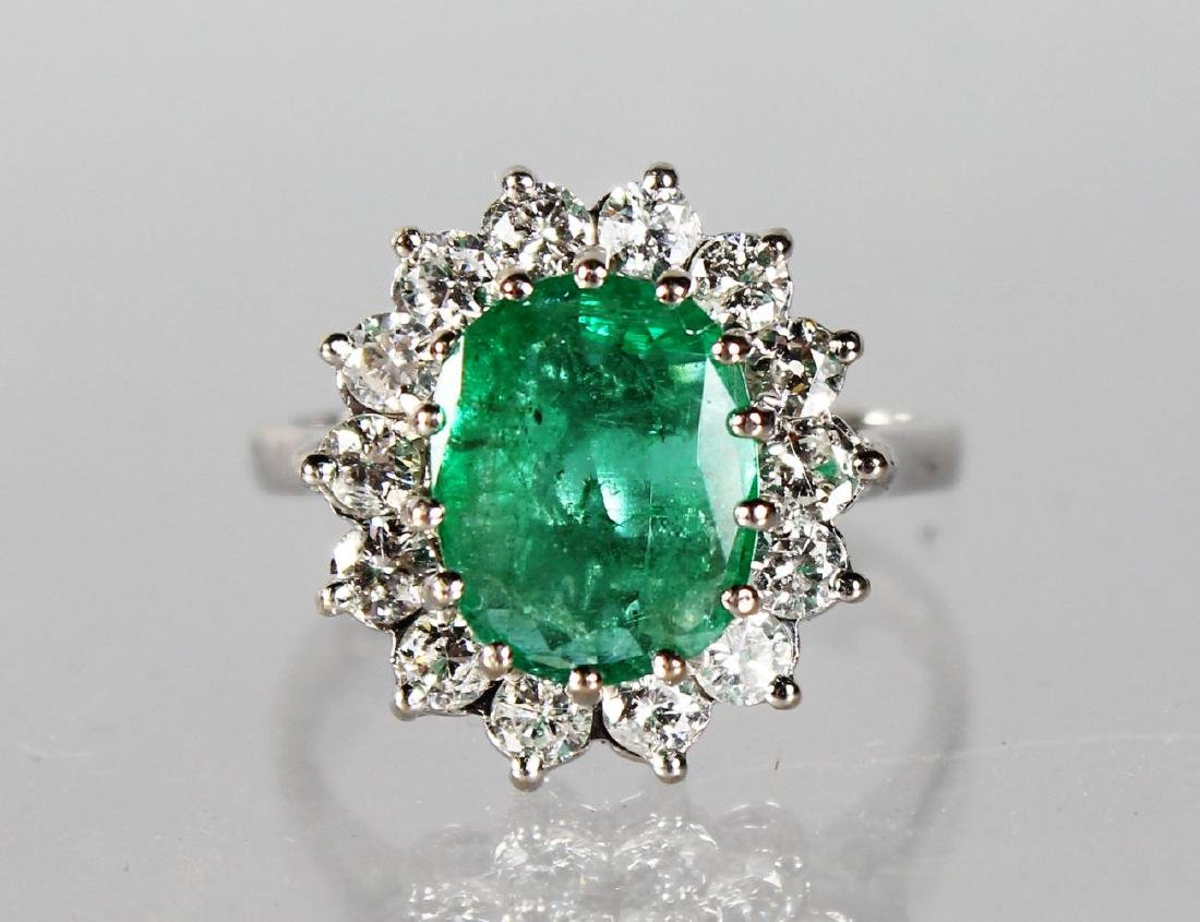 AN 18CT WHITE GOLD SUBSTANTIAL EMERALD AND DIAMOND