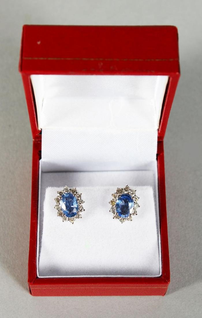 A PAIR OF 18CT WHITE GOLD EARRINGS, the cornflower