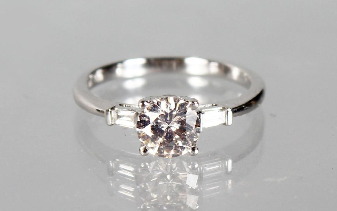 AN 18CT WHITE GOLD DIAMOND RING with central brilliant