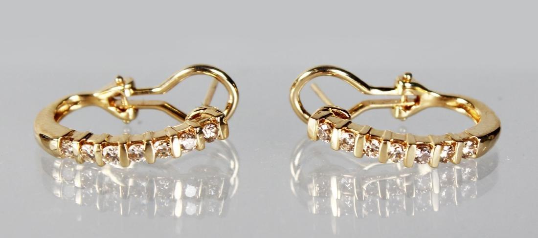 A PAIR OF 14CT YELLOW GOLD DIAMOND HALF HOOP EARRINGS.